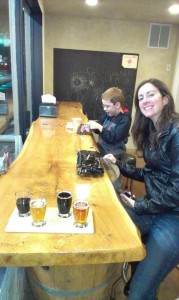 Carole and Brandon in the kids play area of Elizabeth Station Bottle Shop in Bellingham, WA